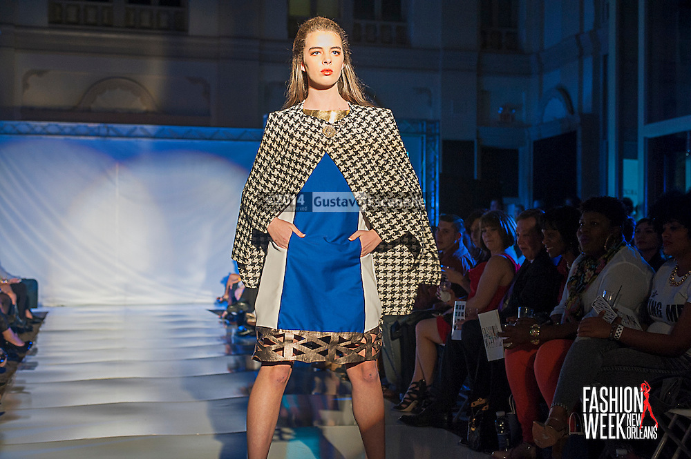 FASHION WEEK NEW ORLEANS: Designer Jose Luis Rodriguez show case his fashion design on the runway at the Board of Trade, Fashion Week New Orleans on Wednesday March 19. 2014. #FWNOLA, #FashionWeekNOLA, #Design #FashionWeekNewOrleans, #NOLA, #Fashion #BoardofTrade, #GustavoEscanelle, #TraceeDundas #DominiqueWhite<br /> View more photos at http://Gustavo.photoshelter.com.
