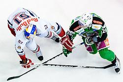 Matthias Trattnig (EC Red Bull Salzburg, #51) and Anze Ropret (HDD Tilia Olimpija, #29) during ice-hockey match between HDD Tilia Olimpija and EC Red Bull Salzburg in 20th Round of EBEL league, on November 6, 2011 at Hala Tivoli, Ljubljana, Slovenia. HDD Tilia Olimpija won in overtime 3:2. (Photo By Matic Klansek Velej / Sportida)
