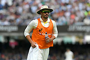Mitchell Starc of Australia on the field on towel and drinks duties during the International Test Match 2019 match between England and Australia at Lord's Cricket Ground, St John's Wood, United Kingdom on 18 August 2019.