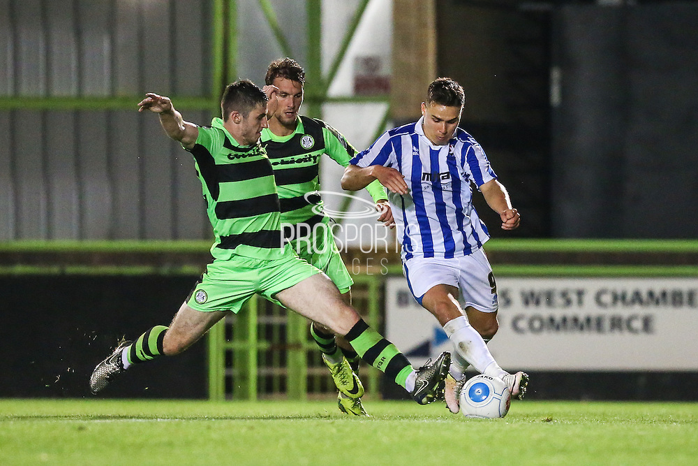 Forest Green Rovers Louis McGrory (22) makes a tackle on Cheltehham Town's Billy Waters during the Gloucestershire Senior Cup match between Forest Green Rovers and Cheltenham Town at the New Lawn, Forest Green, United Kingdom on 20 September 2016. Photo by Shane Healey.