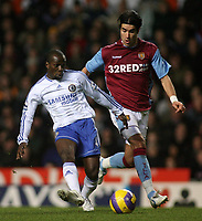 Photo: Paul Thomas.<br /> Aston Villa v Chelsea. The Barclays Premiership. 02/01/2007.<br /> <br /> Claude Makelele (L) of Chelsea passes it past Juan Pablo Angel.