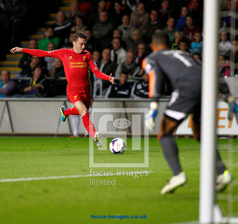 Picture by Mike  Griffiths/Focus Images Ltd +44 7766 223933<br /> 16/09/2013<br /> Philippe Coutinho of Liverpool shoots at goal during the Barclays Premier League match at the Liberty Stadium, Swansea.