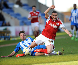 Colchester United's Ryan Dickson tackles Bristol City's Martin Paterson - Photo mandatory by-line: Dougie Allward/JMP - Mobile: 07966 386802 22/03/2014 - SPORT - FOOTBALL - Colchester - Colchester Community Stadium - Colchester United v Bristol City - Sky Bet League One