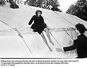 Sliding down the marquee during the New College May Ball. Oxford. 24 June 1983. film 83447f2<br />