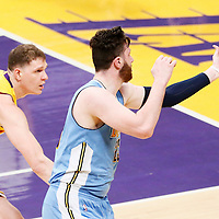 31 January 2017: Denver Nuggets center Jusuf Nurkic (23) reaches for the loose ball past Los Angeles Lakers center Timofey Mozgov (20) during the LA Lakers 120-116 victory over the Denver Nuggets, at the Staples Center, Los Angeles, California, USA.