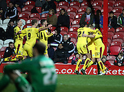 Brentford striker Courtney Senior celebrating scoring Burnley midfielder Scott Arfield during the Sky Bet Championship match between Brentford and Burnley at Griffin Park, London, England on 15 January 2016. Photo by Matthew Redman.