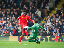 LONDON, ENGLAND - Sunday, May 12, 2013: Liverpool's Daniel Sturridge chips the ball over Fulham's goalkeeper Mark Schwarzer to score the third goal of his hat-trick against Fulham during the Premiership match at Craven Cottage. (Pic by David Rawcliffe/Propaganda)