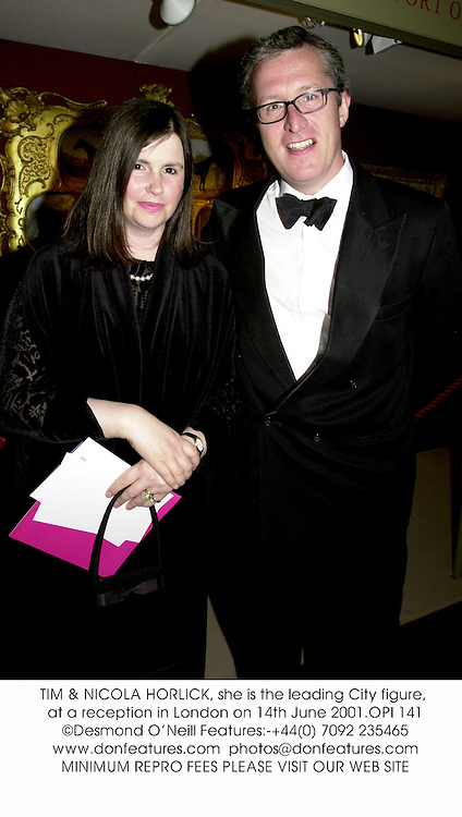 TIM & NICOLA HORLICK, she is the leading City figure, at a reception in London on 14th June 2001.	OPI 141