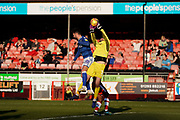 Glenn Morris of Crawley Town is fouled by Reece Cole of Macclesfield Town during the EFL Sky Bet League 2 match between Crawley Town and Macclesfield Town at The People's Pension Stadium, Crawley, England on 23 February 2019.