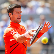 PARIS, FRANCE June 06. Novak Djokovic of Serbia in action against Alexander Zverev of Germany on Court Philippe-Chatrier during the Men's Singles Quarter Final match at the 2019 French Open Tennis Tournament at Roland Garros on June 6th 2019 in Paris, France. (Photo by Tim Clayton/Corbis via Getty Images)