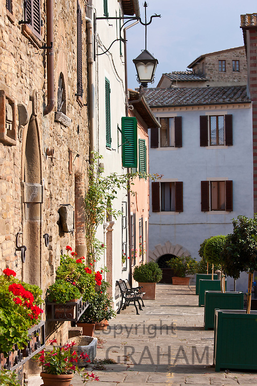 Quaint street scene in old hill town of Montalcino, Val D'Orcia,Tuscany, Italy