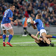 Tim Nanai Williams, passes off to Kahn Fotualii, in the early minutes of the first half.  The New Zealand All Blacks defeated Manu Samoa 15's 83-0 at Eden Park, Auckland, New Zealand.  Photo by Barry Markowitz, 6/16/17