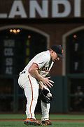San Francisco Giants relief pitcher Mark Melancon (41) stops a Los Angeles Dodgers hit at AT&T Park in San Francisco, California, on April 24, 2017. (Stan Olszewski/Special to S.F. Examiner)
