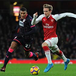 Nacho Monreal of Arsenal under pressure from Colin Quaner of Huddersfield on the ball during Arsenal vs Huddersfield, Premier League, 29.11.17 (c) Harriet Lander | SportPix.org.uk