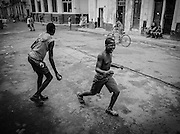 Boys playing baseball in the streets of central Havana.