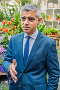 The Mayor Sadiq Khan expresses his concern over the tower block fire and praises the fire service - The market reopening is signified by the ringing of the bell and is attended by Mayor Sadiq Khan. Tourists and locals soon flood back to bring the area back to life.