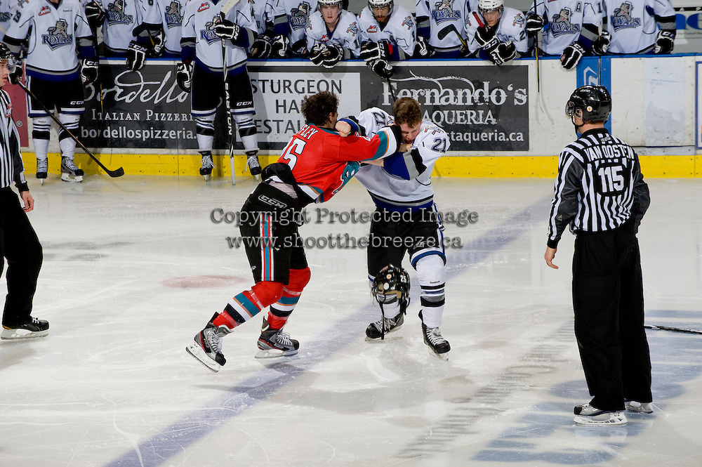 KELOWNA, CANADA, DECEMBER 2: Colton Heffley #25 of the Kelowna Rockets gets in the face of Austin Carroll #21 of the Victoria Royals as the Victoria Royals visit the Kelowna Rockets  on December 2, 2011 at Prospera Place in Kelowna, British Columbia, Canada (Photo by Marissa Baecker/Shoot the Breeze) *** Local Caption ***