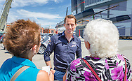 Sir Ben Ainslie chats with locals outside the newly opened BAR (Ben Ainslie Racing) HQ in Portsmouth, Hampshire. The world's most successful Olympic sailor and his team will compete to win the oldest sporting trophy, The America's Cup, in Bermuda in 2017. The first stage of the contest will be held close to the base in Portsmouth next month when competing nations converge on the city for the inaugural America's Cup World Series regatta. <br /> Picture date Wednesday 24th June, 2015.<br /> Picture by Christopher Ison. Contact +447544 044177 chris@christopherison.com