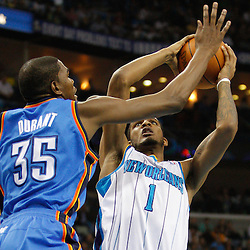 January 24,  2011; New Orleans, LA, USA; New Orleans Hornets small forward Trevor Ariza (1) shoots over Oklahoma City Thunder small forward Kevin Durant (35) during the second quarter at the New Orleans Arena. Mandatory Credit: Derick E. Hingle