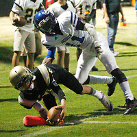 Amory quarterback Hunter Jones scores a touchdown in the end zone as he is defended by Aberdeen's Tywann Walker during Friday night's game against Aberdeen.