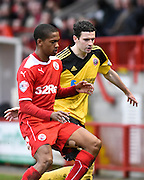 Jamie Murphy challenges Lewis Young for the ball during the Sky Bet League 1 match between Crawley Town and Sheffield Utd at Broadfield Stadium, Crawley, England on 28 February 2015. Photo by David Charbit.