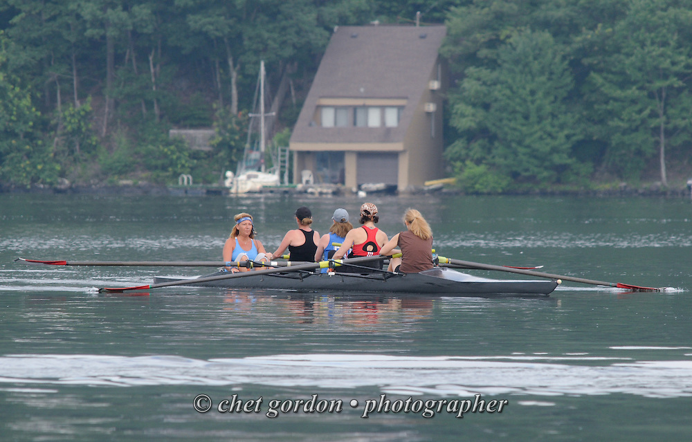 A team of four women and their coxswain during their morning row in Greenwood Lake, NY on Tuesday, July 9, 2013.  © Chet Gordon/THE IMAGE WORKS