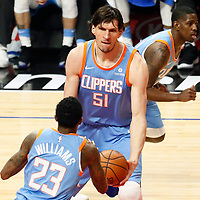 18 March 2018: LA Clippers center Boban Marjanovic (51) passes the ball to LA Clippers guard Lou Williams (23) during the Portland Trail Blazers 122-109 victory over the LA Clippers, at the Staples Center, Los Angeles, California, USA.