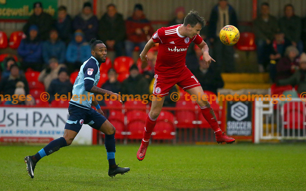 Sean McConville of Accrington heads the ball back away from Crawley's Cedric Evina  during the Sky Bet League 2 match between Accrington Stanley and Crawley Town at the Fraser Eagle Stadium in Accrington. 23 Dec 2017