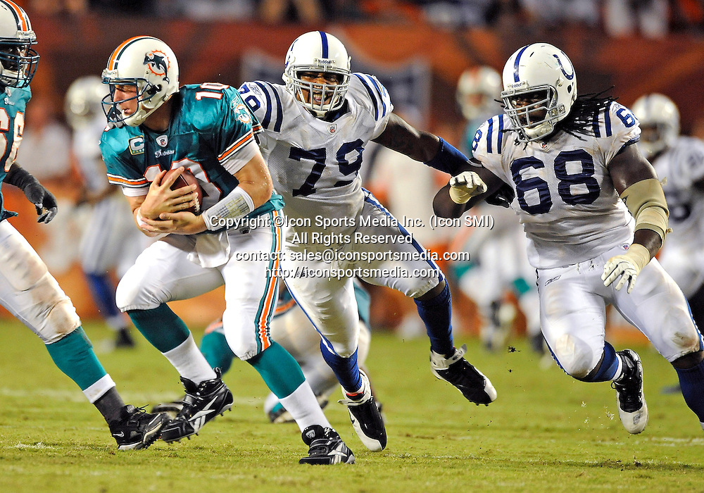 21 September 2009: Miami Dolphins quarterback Chad Pennington (10) is pursued by Indianapolis  Colts defensive tackle Raheem Brock (79) and defensive tackle Eric Foster (68) in the Colts' 27-23 victory at Land Shark Stadium, Miami, Florida.
