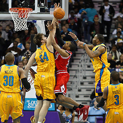 February 12, 2011; New Orleans, LA, USA; New Orleans Hornets center Aaron Gray (34) blocks a shot by Chicago Bulls point guard C.J. Watson (32)  during the second quarter at the New Orleans Arena.   Mandatory Credit: Derick E. Hingle