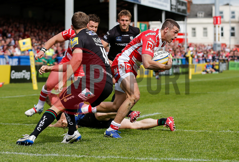 Gloucester Winger Jonny May gets away from the tackle by London Irish Winger James Short going on  to score a try - Photo mandatory by-line: Rogan Thomson/JMP - 07966 386802 - 09/05/2015 - SPORT - RUGBY UNION - Gloucester, England - Kingsholm Stadium - Gloucester Rugby v London Irish - Aviva Premiership.