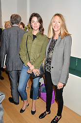 Left to right, ETTY BELLHOUSE and the HON.FLORA GOODWIN at a private view of photographs by Jolyon Fenwick 'The Zero Hours Panoramas' 100 Years On: Views From The Parapet of The Somme held at Sladmore Contemporary, 32 Bruton Place, London on 30th June 2016.