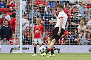 Manchester United 08 XI Michael Carrick kicks the ball to his son in warm up during the Michael Carrick Testimonial Match between Manchester United 2008 XI and Michael Carrick All-Star XI at Old Trafford, Manchester, England on 4 June 2017. Photo by Phil Duncan.