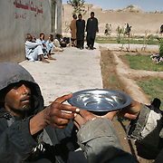 16 October 2004&#xD;&#xA;Herat, Afghanistan.&#xD;&#xA;Mental health care/Afghanistan.&#xD;&#xA;&#xD;&#xA;&#xD;&#xA;After decades of war and deprivation Afghanistans mental health programes struggle to provide any real relief or treatment for those suffering from various psychological problems. Some of the patients symtoms have been caused by the trauma of witnessing their family members killed during the years of fighting, for others the problems are a result of heavy drug abuse. At this time it is estimated that there are 62,000 addicted to drugs in Kabul alone. Treatment for the mentaly disabled is almost non existent, it consits rather of containment and basic health care. The patients are fed, have a roof over their heads and are kept seperate from the general public, some are kept chained together to prevent escape. Local clinics provide antibiotic vaccinations to help prevent infections caused by the unclean living conditions, they also treat a range of injuries that the patients often inflict on themselves and each other. Whilst some medicines are available to help correct chemical imbalances that affect the mental state these are limited in quantity and effectiveness. Counciling and therapy were not forms of treatment offered in any of the institutions visited.<br />