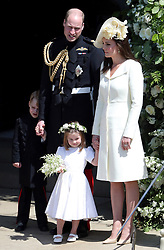 The Duke and Duchess of Cambridge with Prince George and Princess Charlotte leave St George's Chapel in Windsor Castle after the wedding.