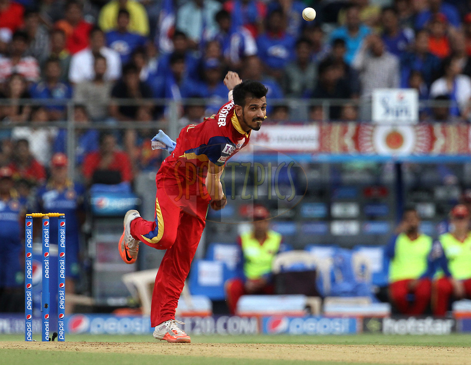 Royal Challengers Bangalore player Yuzvendra Chahal bowls during match 46 of the Pepsi IPL 2015 (Indian Premier League) between The Mumbai Indians and The Royal Challengers Bangalore held at the Wankhede Stadium in Mumbai, India on the 10th May 2015.<br /> <br /> Photo by:  Vipin Pawar / SPORTZPICS / IPL
