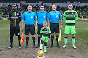 Captains, officials and mascot during the EFL Sky Bet League 2 match between Forest Green Rovers and Yeovil Town at the New Lawn, Forest Green, United Kingdom on 16 February 2019.