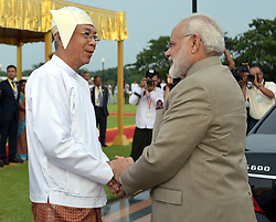 September 5, 2017 - Nay Pyi Taw, Myanmar - Indian Prime Minister Narendra Modi, right, is greeted by Myanmar President U. Htin Kyaw during arrival ceremonies September 5, 2017 in Nay Pyi Taw, Myanmar. (Credit Image: © Lalit Kumar/Planet Pix via ZUMA Wire)