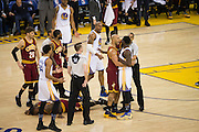 Golden State Warriors and Cleveland Cavaliers players get into a scrum at half court after Cleveland Cavaliers forward LeBron James (23) collided with Golden State Warriors forward Draymond Green (23) in the second quarter at Oracle Arena in Oakland, Calif., on January 16, 2017. (Stan Olszewski/Special to S.F. Examiner)