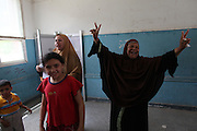 An Egyptian reacts after casting her ballot  at a polling station in the El Mokattam neighborhood of  Cairo , Egypt May 23, 2012. Egyptians head to the polling stations throughout Egypt  Wednesday for an historic opportunity in which they will for the first time to pick their president in a wide open election that pits Islamists against men who served under deposed leader Hosni Mubarak.(Photo by Heidi Levine/Sipa Press).