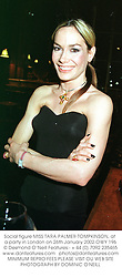 Social figure MISS TARA PALMER-TOMPKINSON, at a party in London on 26th January 2002.OWY 196
