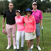 Joe Fieweger and his mom, Mary, Becky Knutson, and John Fieweger pose for a picture during the annual Pink Ball Tournament in Charbonneau.<br /> Photo by Jaime Valdez