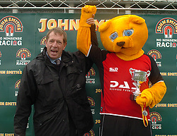 WINNER OF 2008 JOHN SMITHS MASCOT GRAND NATIONAL, WACKY MACKY OF SAFFRON WALDEN FC, ON WINNERS STAND WITH HIS WINNING MEDAL, AND TROPHY, AND TV RACE COMMENTATOR DEREK THOMPSON, , John Smiths Mascot Grand National, Huntingdon Racecourse Sunday 5th October 2008