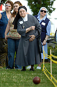 Sr. Maria Augustine Giannini, a Sister of Charity of St. Joan Antida, tosses a bocce ball during the St. Joan Antida High School reunion at the Summerfest grounds in Milwaukee July 22. The girls high school, sponsored by the Sisters of Charity, held its annual reunion at the festival grounds during Festa Italiana. The bocce tournament pits St. Joan Antida faculty and alumnae against the sisters. Sr. Maria Augustine turns 90 in October. (Photo by Sam Lucero)