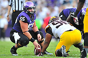 FORT WORTH, TX - SEPTEMBER 13:  Joey Hunt #55 of the TCU Horned Frogs lines up against the Minnesota Golden Gophers on September 13, 2014 at Amon G. Carter Stadium in Fort Worth, Texas.  (Photo by Cooper Neill/Getty Images) *** Local Caption *** Joey Hunt