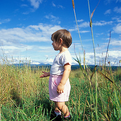 East Montpelier, VT. A young girl plays in a field on the Mallory Brook property.