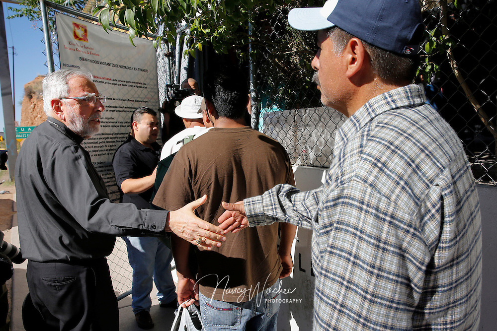 "Bishop Gerald F. Kicanas of Tucson greets men entering the soup kitchen of the Kino Border Initiative in Nogales, in the Mexican state of Sonora, in this 2014 photo. The bishop said he welcomed the news the Vatican had created of the Diocese of Nogales, saying that the Tucson Diocese and comprising the new diocese have ""many common pastoral concerns."" (CNS photo/Nancy Wiechec) See NOGALES-REACT (UPDATED) March 27, 2015."