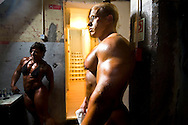 For two years in a row, in a rundown theater in Porto, the Portuguese National Championship of Bodybuilding WABBA happened. Several athletes, from allover the country came to this one day competition. <br /> These are photos from the backstage, where the athletes exercise and get body paint for the stage presentation. The muscles and the gold and brown colors get ready in the confusion of tubes, abandoned wood from different theater plays, photos from the past and dressing rooms with 100 years old.  World champion WABBA 2008, the hungarian Daniel Toth and Eunice Miranda.