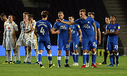 Alex Woodyard of Peterborough United is consoled by team-mates after missing his penalty - Mandatory by-line: Joe Dent/JMP - 04/09/2018 - FOOTBALL - Stadium MK - Milton Keynes, England - Milton Keynes Dons v Peterborough United - Checkatrade Trophy