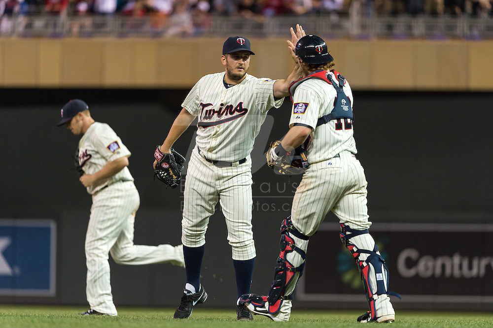 Glen Perkins #15 and Chris Herrmann #12 of the Minnesota Twins celebrate after the Twins defeated the Milwaukee Brewers on May 29, 2013 at Target Field in Minneapolis, Minnesota.  The Twins defeated the Brewers 4 to 1.  Photo: Ben Krause